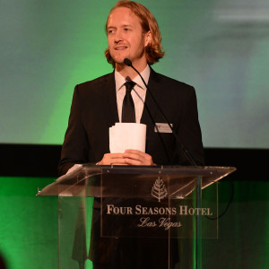 """LAS VEGAS, NV - SEPTEMBER 24:  Mac Reynolds speaks at the """"Imagine A World Without Cancer"""" Gala at the Fours Seasons Hotelon September 24, 2015 in Las Vegas, Nevada.  (Photo by Denise Truscello/WireImage) *** Local Caption *** Mac Reynolds"""